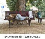 Homeless Man Sleeping On A...