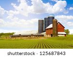 Red Dairy Farm With Sunny Sky