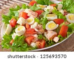fresh salmon salad, lettuce and quail eggs - stock photo