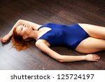 Model in swimsuit lying - stock photo