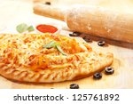 Freshly baked homemade pizza - stock photo