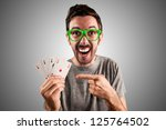 winner guy holding poker cards on grey background - stock photo