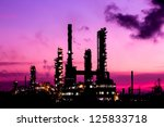 silhouette oil refinery plant and smoke at twilight morning - stock photo