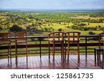 Savanna landscape in Serengeti, Tanzania, Africa. Chairs on the terrace for observation - stock photo