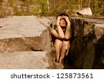 Sexy woman trapped in stones - stock photo