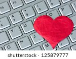 red heart on the computer... | Shutterstock . vector #125879777