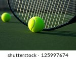 Tennis Ball and Racket Close Up with room for copy - stock photo