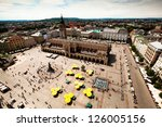 KRAKOW, POLAND - JULY 18: View of the Main Square - historical center of Krakow, May 18, 2012 in Krakow, Poland. This year the city was visited by 8.1 million tourists, which is the highest level. - stock photo
