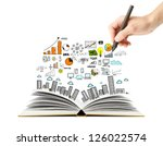 hand drawing business scheme and open book - stock photo