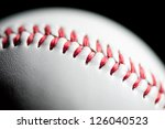 Macro shot of a baseball over black background, shallow depth of field - stock photo