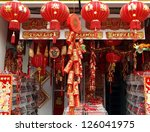 KAOHSIUNG, TAIWAN - JANUARY 22: With Chinese New Year approaching stores sell New Year decorations. This store offers lanterns, firecrackers, posters and other items on January 22, 2013 in Kaohsiung. - stock photo