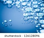 drops of on glass treat water-repellent in macro lens shot - stock photo