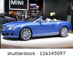 DETROIT - JANUARY 27 :The new 2014 Bentley Continental GTC Convertible at The North American International Auto Show January 27, 2013 in Detroit, Michigan. - stock photo