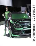 DETROIT - JANUARY 27 :The KIA green hornet concept at The North American International Auto Show January 27, 2013 in Detroit, Michigan. - stock photo