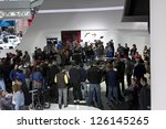 DETROIT - JANUARY 27 :The crowd gathering around the new 2014 Chevrolet Corvette stringray C7 at The North American International Auto Show January 27, 2013 in Detroit, Michigan. - stock photo