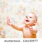 laughing baby looks up and... | Shutterstock . vector #126150977
