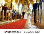 Beautiful candle wedding decoration in a church - stock photo