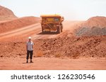 Mining truck working in iron ore mines, Western Australia - stock photo
