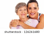 happy senior mother and adult daughter closeup portrait on white - stock photo