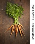 Carrots on wooden table - stock photo