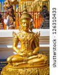 gold statues of buddha in a