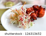 Spicy tandoori chicken and cabbage salad - stock photo