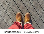 Shoes from an aerial view on wooden background - stock photo