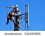 two technicians working on a... | Shutterstock . vector #126334583