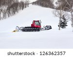 A Snow Groomer Preparing The...