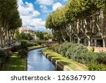 Picturesque view of Perpignan and its river in a sunny day. France. - stock photo