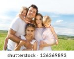 happy young family with three... | Shutterstock . vector #126369893