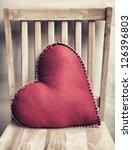 heart shaped pillow on wooden... | Shutterstock . vector #126396803