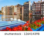Traditional dutch buildings in Amsterdam - stock photo