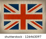 Vintage Union Jack flag on crumpled brown paper. EPS10 vector format. - stock vector