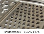 Close-up of metal cheese grater - stock photo