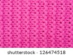 a background of red knitted fabrics - stock photo