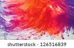 Ink dispersing in water - stock photo