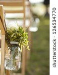 detail from wedding of bouquet in mason jar. - stock photo