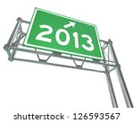 A Green Freeway Sign With The...