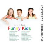 cute kids with white board with sample text - stock photo