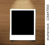 blank photo frame on brown wood ... | Shutterstock . vector #126647003