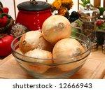 bowl of onions in peel in...