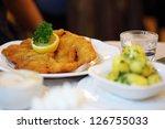wiener schnitzel on table in... | Shutterstock . vector #126755033