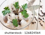 Bowl of boiled pelmeni, studio shot, view from above - stock photo