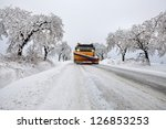 snow plow during maintenance road in winter - stock photo