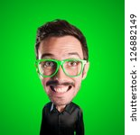 puppet man with big head on green background - stock photo