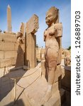 Small photo of LUXOR, EGYPT - OCTOBER 18: Amun Re and Amunet Dyad statue on October 18, 2012 at the Karnak Temple in Luxor, Egypt