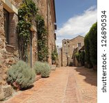 narrow brick street in tuscan small town, Sovana, Tuscany, Italy, Europe - stock photo
