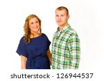 an attractive couple against a... | Shutterstock . vector #126944537