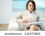 Portrait of a friendly counselor being ready to take notes - stock photo